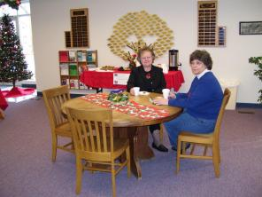 Patrons enjoy the one of the many sitting areas of the library.