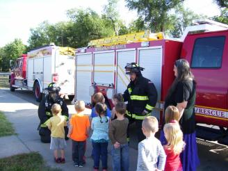 Firefighters teach children about fire safety.