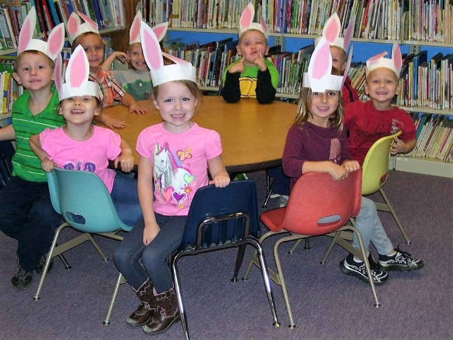 Children make their very own bunny ears for Easter.