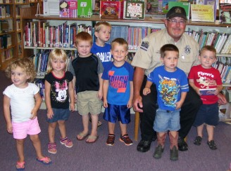 Children visit with the local Game Warden.