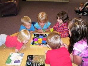 Children enjoy puzzles and games in the Children's section of the library.